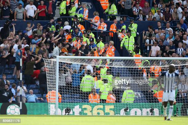 Stoke City fans clash with the police and stewards during the Premier League match between West Bromwich Albion and Stoke City at The Hawthorns on...