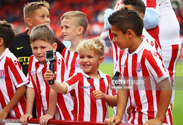 Stoke City fans enjoy the atmosphere with a go pro prior to kick off during the Premier League match between Stoke City and Manchester City at Bet365...