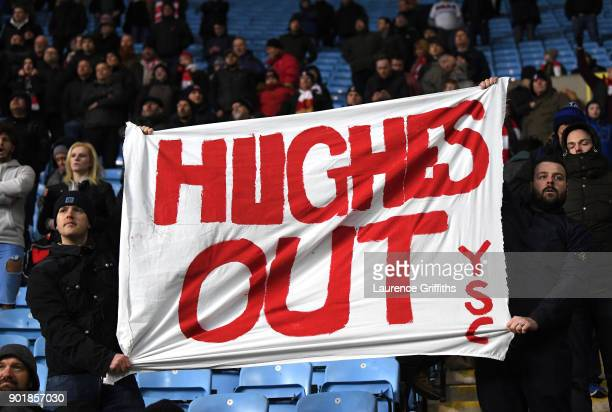 Stoke City fans hold up their Mark Hughes out banner during the The Emirates FA Cup Third Round match between Coventry City and Stoke City at Ricoh...