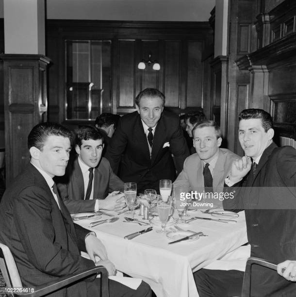 Stoke City FC soccer players Eric Skeels Keith Bebbington Stan Matthews Peter Dobing John Ritchie at dinner together UK 25th January 1964