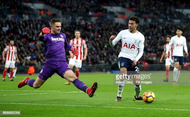 Stoke City goalkeeper Jack Butland and Tottenham Hotspur's Dele Alli battle for the ball during the Premier League match at Wembley Stadium London