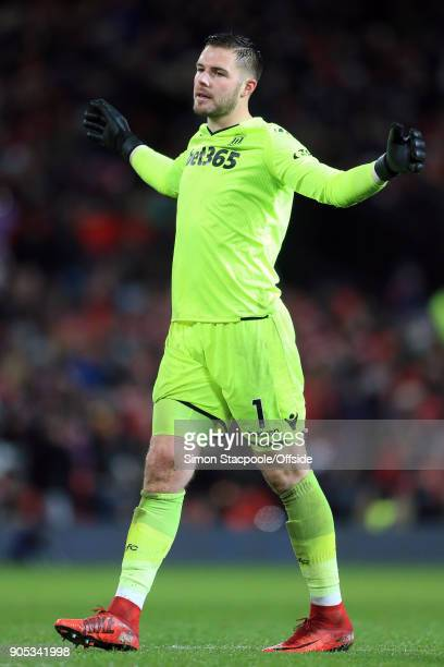 Stoke City goalkeeper Jack Butland looks dejected after conceding three goals during the Premier League match between Manchester United and Stoke...