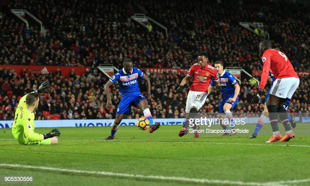 Stoke City goalkeeper Jack Butland saves the shot of Anthony Martial of Manchester United during the Premier League match between Manchester United...