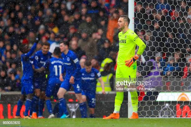 Stoke City goalkeeper Jack Butland shows his dejection as Everton celebrate scoring their sides first goal of the match during the Premier League...