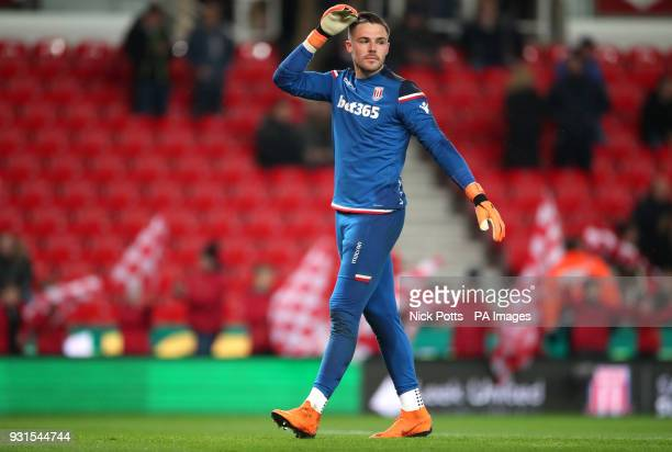 Stoke City goalkeeper Jack Butland warming up before the game