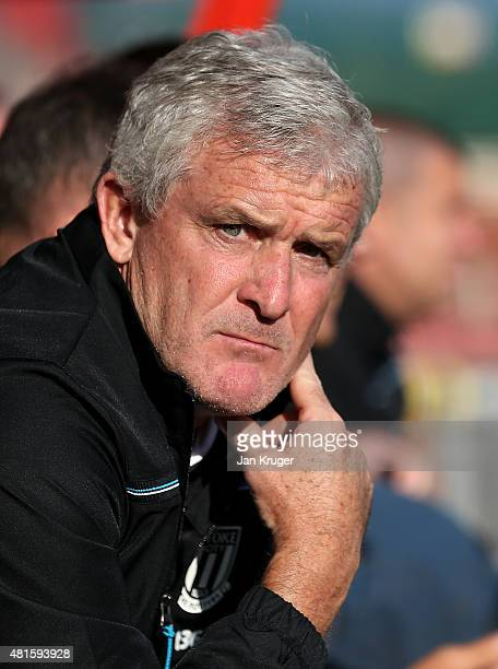 Stoke City manager Mark Hughes looks on during the pre season friendly match between Wrexham and Stoke City at Racecourse Ground on July 22 2015 in...