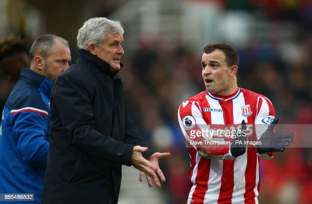 Stoke City manager Mark Hughes talks to Stoke City's Xherdan Shaqiri during the Premier League match at the Bet35 Stadium StokeonTrent