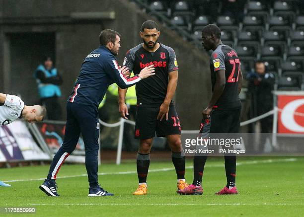 Stoke City manager Nathan Jones gives instruction to Stoke City's Cameron CarterVickers and Badou Ndiaye during the Sky Bet Championship match at the...