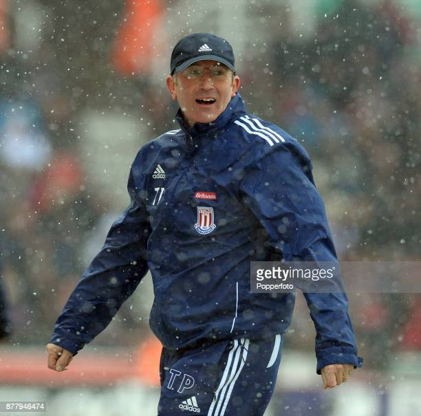 Stoke City manager Tony Pulis during the Barclays Premier League match between Stoke City and Sunderland as the snow falls at the Britannia Stadium...