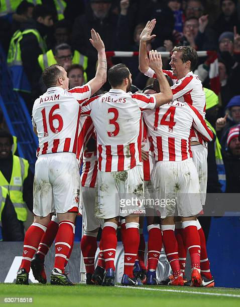 Stoke City players celebrate their side's first goal by Bruno Martins Indi during the Premier League match between Chelsea and Stoke City at Stamford...