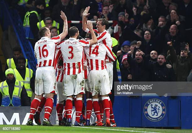 Stoke City players celebrate their side's first goal during the Premier League match between Chelsea and Stoke City at Stamford Bridge on December 31...