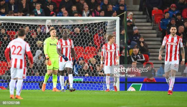 Stoke City players look dejected as David Silva of Manchester City scores their first goal during the Premier League match between Stoke City and...