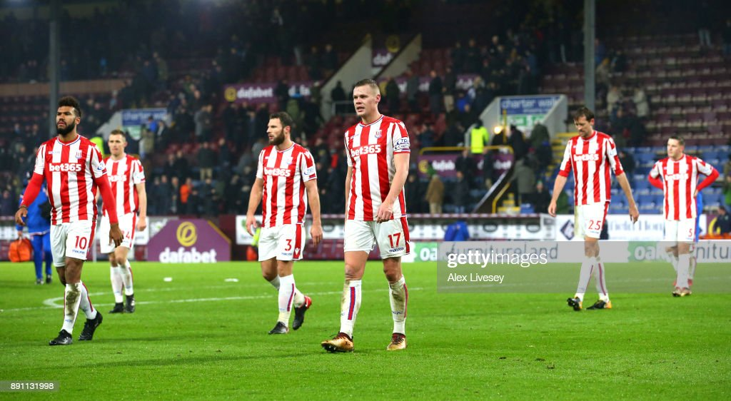 Stoke City players look dejected as they leave the pitch after losing the Premier League match between Burnley and Stoke City at Turf Moor on December 12, 2017 in Burnley, England.