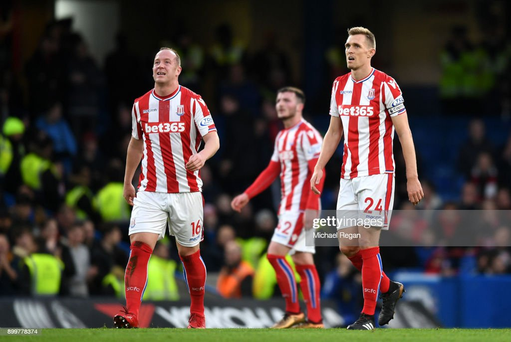 Stoke City players look dejected during the Premier League match between Chelsea and Stoke City at Stamford Bridge on December 30, 2017 in London, England.