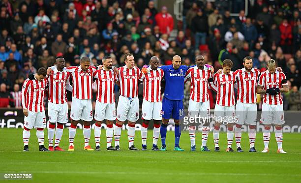 Stoke City players observe a minutes silence for the victims of the plane crash involving the Brazilian club Chapecoense prior to the Premier League...