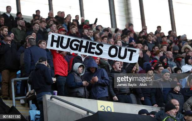 Stoke City supporters hold aloft a banner saying 'Hughes Out' during The Emirates FA Cup Third match between Coventry City and Stoke City at Ricoh...