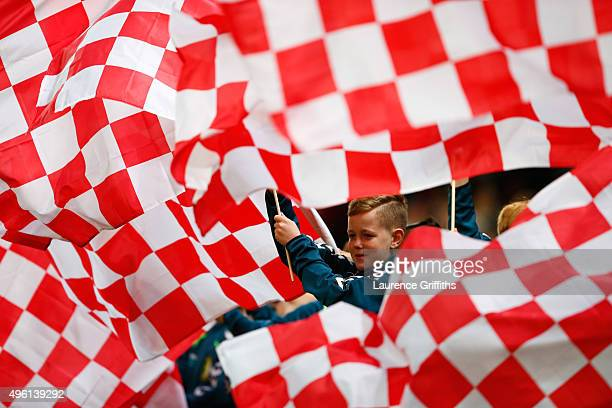 Stoke City supporters wave flags prior to the Barclays Premier League match between Stoke City and Chelsea at Britannia Stadium on November 7 2015 in...