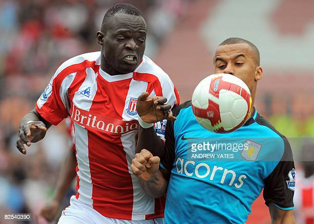 Stoke City's Abodoulaye Faye vies with Aston Villa's English forward Gabriel Agbonlahor during the Premier league football match at The Britannia...
