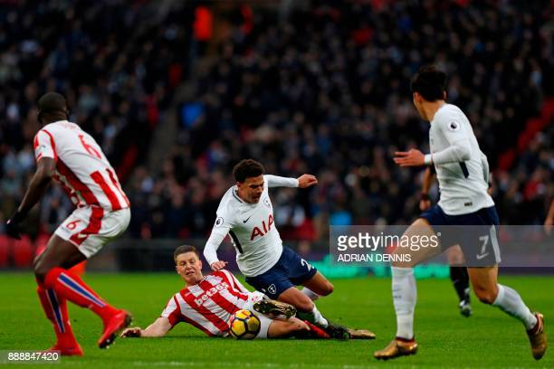 Stoke City's Austrian defender Kevin Wimmer tackles Tottenham Hotspur's English midfielder Dele Alli during the English Premier League football match...