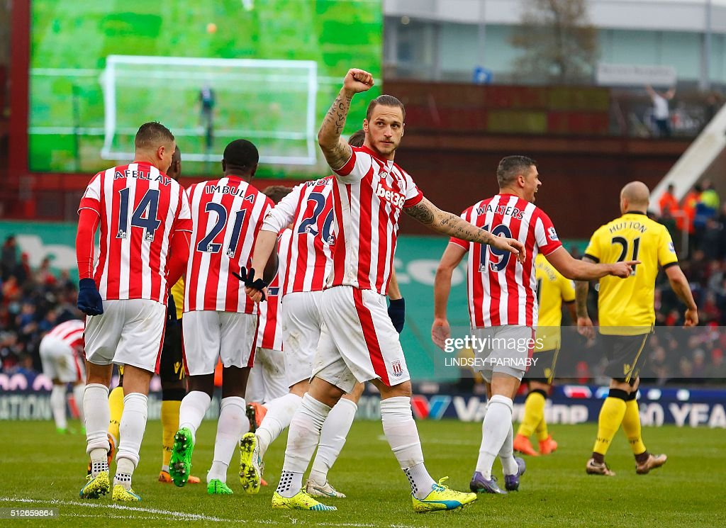 Stoke City's Austrian striker Marko Arnautovic (C) celebrates after scoring during the English Premier League football match between Stoke City and Aston Villa at the Britannia Stadium in Stoke-on-Trent, central England on February 27, 2016. / AFP / LINDSEY PARNABY / RESTRICTED TO EDITORIAL USE. No use with unauthorized audio, video, data, fixture lists, club/league logos or 'live' services. Online in-match use limited to 75 images, no video emulation. No use in betting, games or single club/league/player publications. /