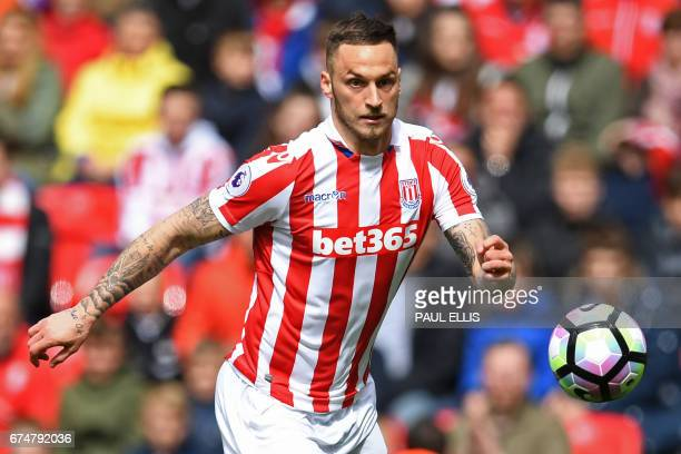Stoke City's Austrian striker Marko Arnautovic chases the ball during the English Premier League football match between Stoke City and West Ham...