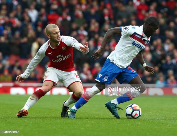 Stoke City's Badou Ndiaye holds of Arsenal's Jack Wilshere during English Premier League match between Arsenal against Stoke City at Emirates stadium...