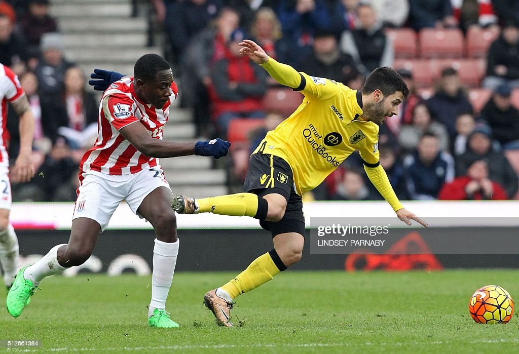 Stoke City's Belgian midfielder Gianelli Imbula (L) vies with Aston Villa's Spanish midfielder Carles Gil during the English Premier League football match between Stoke City and Aston Villa at the Britannia Stadium in Stoke-on-Trent, central England on February 27, 2016. Stoke won the game 2-1. / AFP / LINDSEY PARNABY / RESTRICTED TO EDITORIAL USE. No use with unauthorized audio, video, data, fixture lists, club/league logos or 'live' services. Online in-match use limited to 75 images, no video emulation. No use in betting, games or single club/league/player publications. /