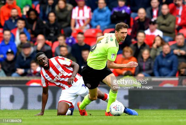 Stoke City's Bruno Martins Indi and Sheffield United's Chris Basham battle for the ball during the Sky Bet Championship match at the bet365 Stadium...
