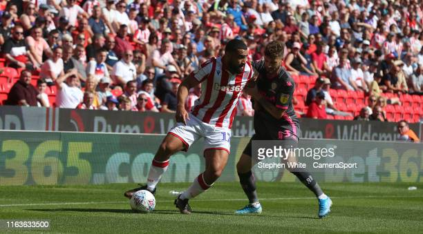 Stoke City's Cameron CarterVickers shields the ball from Leeds United's Mateusz Klich during the Sky Bet Championship match between Stoke City and...
