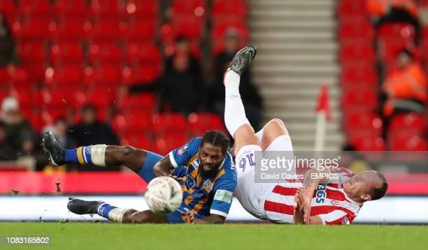 Stoke City's Charlie Adam and Shrewsbury's Anthony Grant Stoke City v Shrewsbury FA Cup Third Round Replay bet365 Stadium