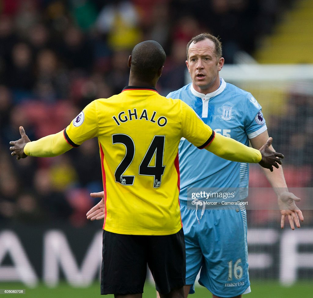Stoke City's Charlie Adam argues with Watford's Odion Ighalo during the Premier League match between Watford and Stoke City at Vicarage Road on November 27, 2016 in Watford, England.