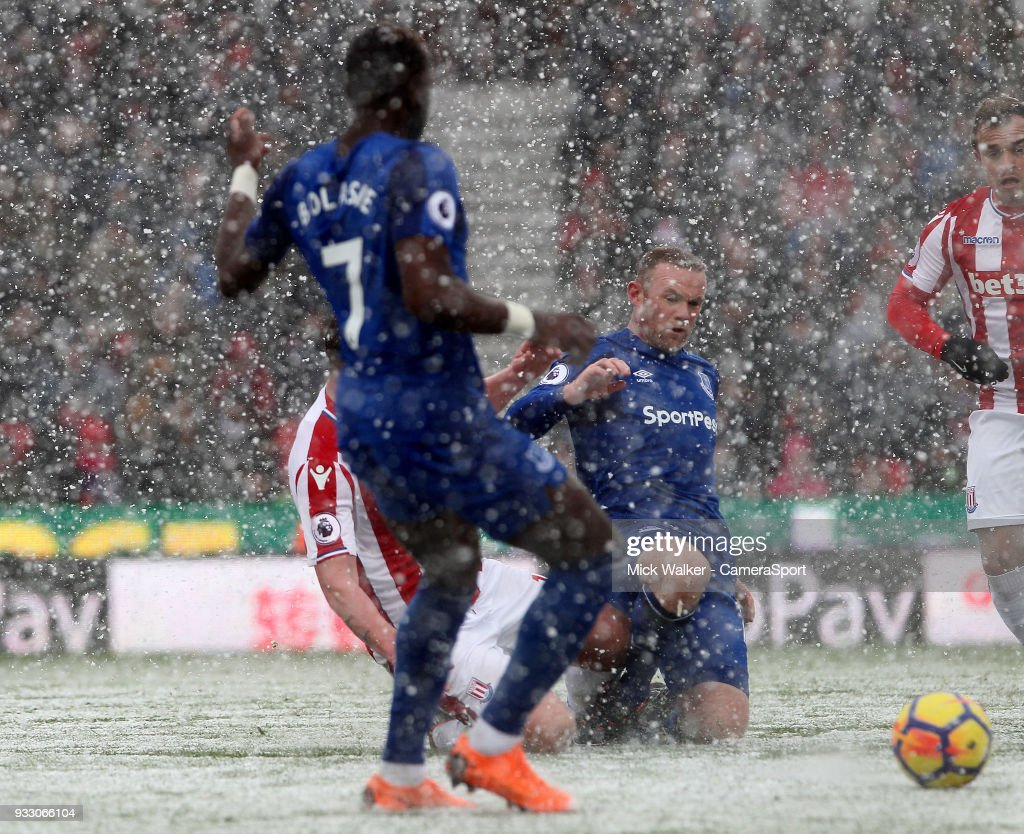 Stoke City's Charlie Adam is sent off for this tackle on Everton's Wayne Rooney during the Premier League match between Stoke City and Everton at Bet365 Stadium on March 17, 2018 in Stoke on Trent, England.