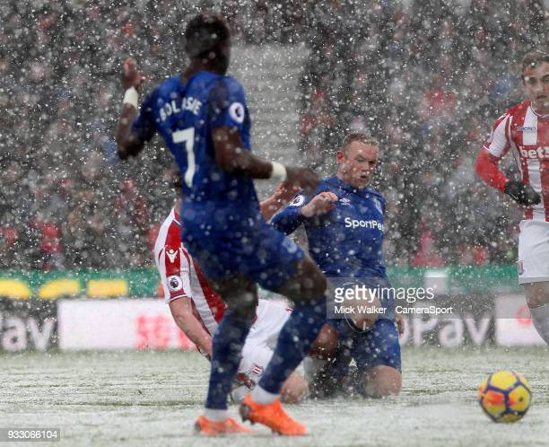 Stoke City's Charlie Adam is sent off for this tackle on Everton's Wayne Rooney during the Premier League match between Stoke City and Everton at...