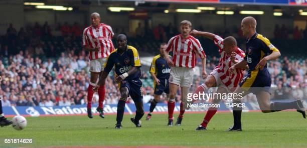 Stoke City's Deon Burton gets between the Brentford's Darren Powell and Michael Dobson to open the scoring