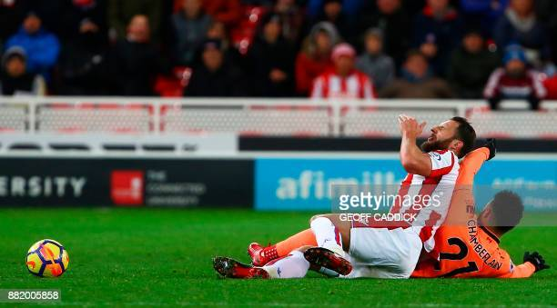 Stoke City's Dutch defender Erik Pieters vies with Liverpool's English midfielder Alex OxladeChamberlain during the English Premier League football...