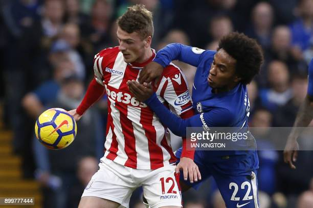 Stoke City's English defender Josh Tymon vies with Chelsea's Brazilian midfielder Willian during the English Premier League football match between...