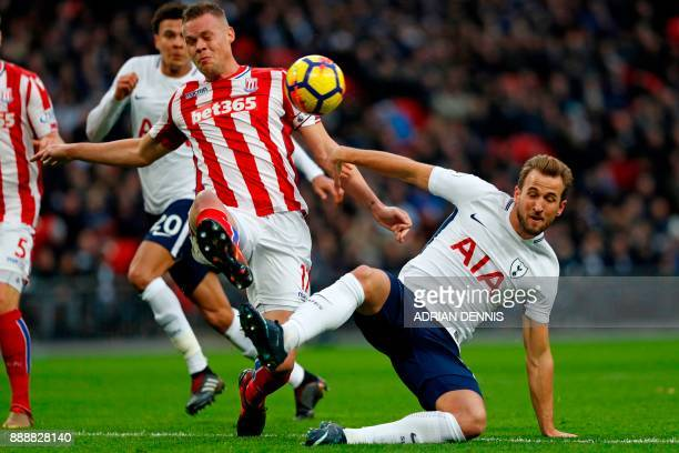 Stoke City's English defender Ryan Shawcross deflects the ball into his own net as Tottenham take an early lead in the English Premier League...