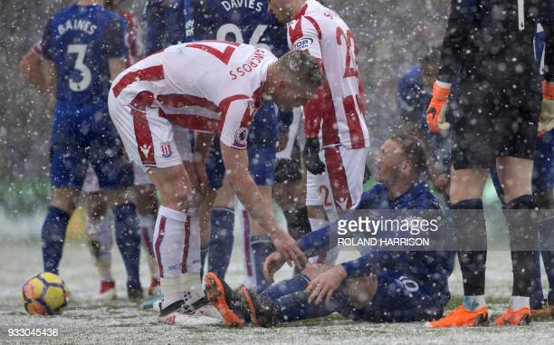 Stoke City's English defender Ryan Shawcross talks to injured Everton's English striker Wayne Rooney during the English Premier League football match...
