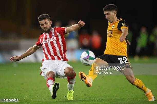 Stoke City's English defender Tommy Smith vies with Wolverhampton Wanderers' Portuguese defender Ruben Vinagre during the English League Cup second...
