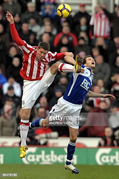 Stoke City's English forward James Beattie vies with Birmingham City's English defender Roger Johnson during the English Premier League football...