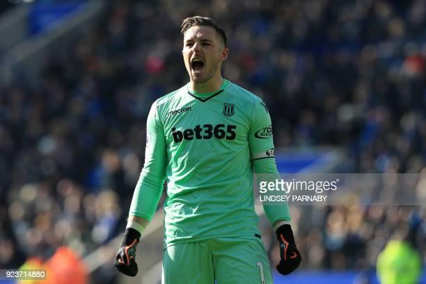 Stoke City's English goalkeeper Jack Butland celebrates Shaqiri's opening goal during the English Premier League football match between Leicester...