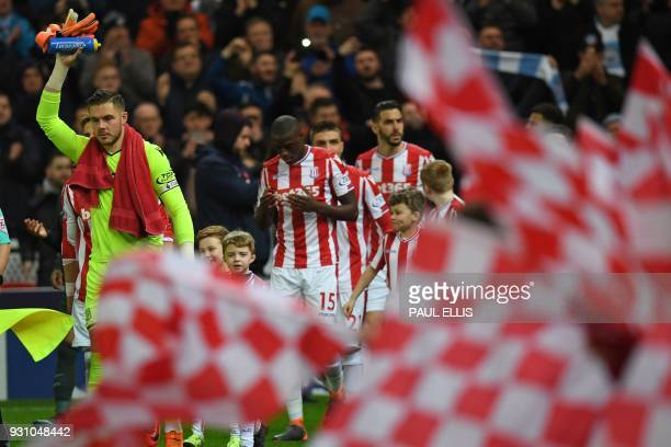 Stoke City's English goalkeeper Jack Butland leads the team out ahead of the English Premier League football match between Stoke City and Manchester...