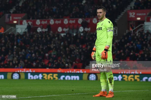 Stoke City's English goalkeeper Jack Butland looks on during the English Premier League football match between Stoke City and Manchester City at the...
