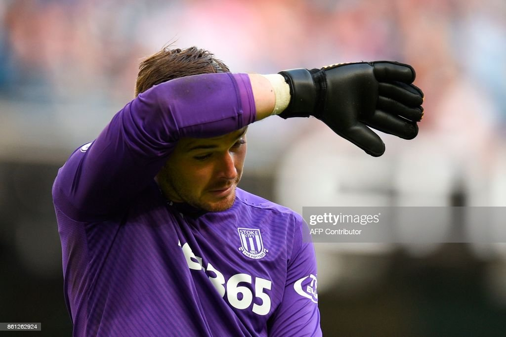 Stoke City's English goalkeeper Jack Butland reacts after Manchester City's seventh goal during the English Premier League football match between Manchester City and Stoke City at the Etihad Stadium in Manchester, north west England, on October 14, 2017. / AFP PHOTO / Oli SCARFF / RESTRICTED TO EDITORIAL USE. No use with unauthorized audio, video, data, fixture lists, club/league logos or 'live' services. Online in-match use limited to 75 images, no video emulation. No use in betting, games or single club/league/player publications. /