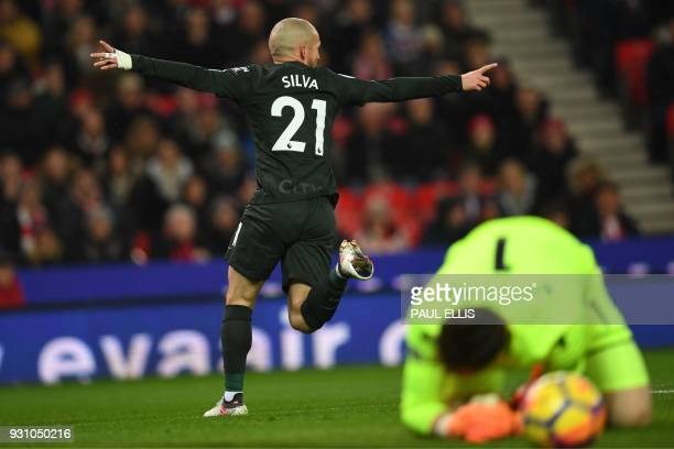Stoke City's English goalkeeper Jack Butland reacts as Manchester City's Spanish midfielder David Silva celebrates after scoring the opening goal of...
