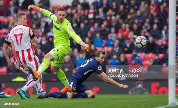 Stoke City's English goalkeeper Jack Butland watches the ball struck by Tottenham Hotspur's Danish midfielder Christian Eriksen roll into his net to...