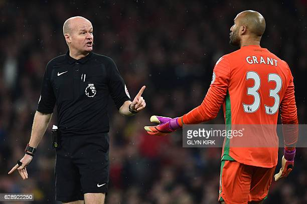 Stoke City's English goalkeeper Lee Grant speaks with the referee during the English Premier League football match between Arsenal and Stoke City at...