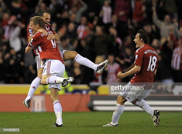 Stoke City's English midfielder Matthew Etherington celebrates with Stoke City's English defender Ryan Shawcross and Stoke City's English midfielder...