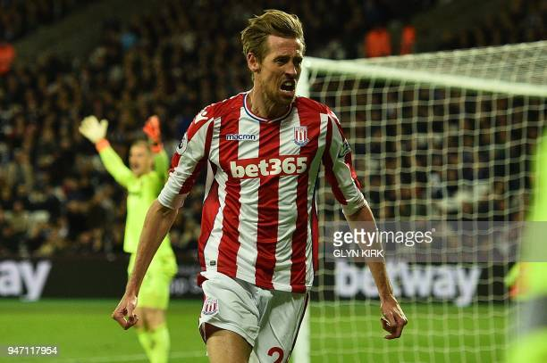 Stoke City's English striker Peter Crouch celebrates scoring the opening goal during the English Premier League football match between West Ham...