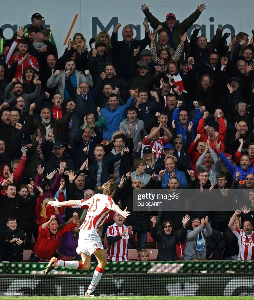 Stoke City's English striker Peter Crouch celebrates Stoke's second goal during the English Premier League football match between Stoke City and Hull City at the Bet365 Stadium in Stoke-on-Trent, central England on April 15, 2017. / AFP PHOTO / Oli SCARFF / RESTRICTED TO EDITORIAL USE. No use with unauthorized audio, video, data, fixture lists, club/league logos or 'live' services. Online in-match use limited to 75 images, no video emulation. No use in betting, games or single club/league/player publications. /